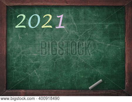 New Year 2021 Concept: Inscription 2021 Written On A Chalkboard Blackboard
