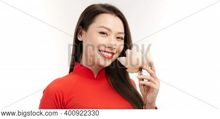 Attractive Happiness Young Vietnamese Woman In Ao Dai Dress Carrying Lotus Flower