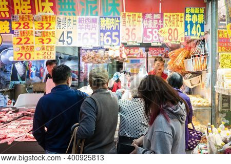 Hong Kong,march 24,2019:people Among The Classic Markets In The Narrow And Crowded Streets Of Hong K
