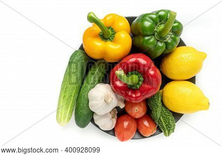 Fresh Fruits And Vegetables In Black Plate. Organic Food. Vegan Food Concept. Healthy Diet Eating Fo