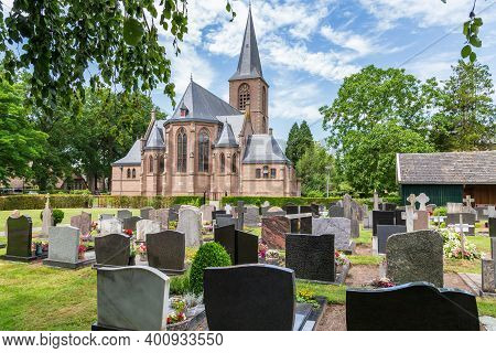 Rechteren, Netherlands - June 20, 2020: Protestant Gothic Church And Cemetry Of The Little Dutch Vil