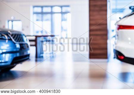 New Cars At Dealer Showroom Blurred Background