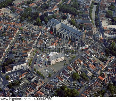 Gouda, Holland, September 04 - 1986: Historical aerial photo of the center of Gouda with the Market square, town hall and Sint Janskerk