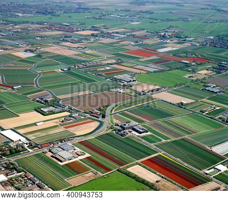 Teylingen, Voorhout, Holland, May 16 - 1986: Historical aerial photo of the colorful flower fields near Teylingen, Voorhout in the provine Zuid Holland