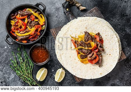 Beef Steak Fajitas With Tortilla, Mix Pepper And Onion Traditional Mexican Food. Black Background. T