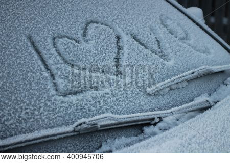 The Word Love On The Frozen Windshield Of A Passenger Car
