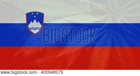 Medical Cannabis In The Slovenia. Leaf Of Cannabis Marijuana On The Flag Of Slovenia. Weed Decrimina