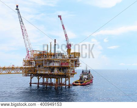 Supply Boat Transfer Cargo To Oil And Gas Industry And Moving Cargo From The Boat To The Platform, B