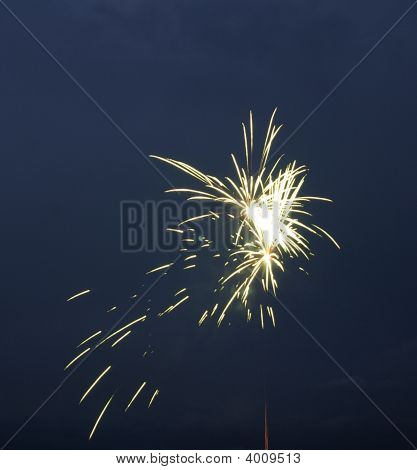 large and small fireworks explode together the sky