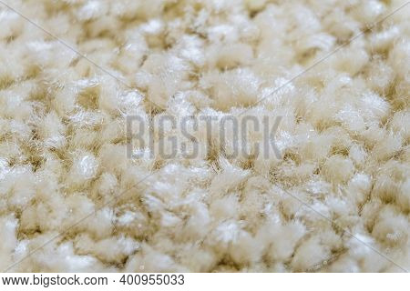 Beige Wool Carpet Close-up. Frieze Material Carpeting. Limited Depth Of Field.