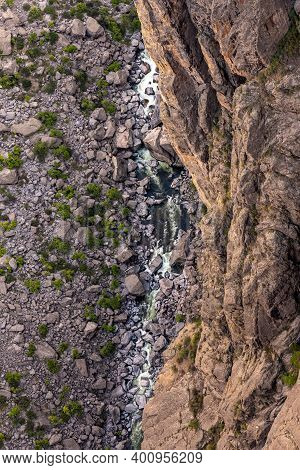 The Gunnison River Far Below The Rim Of The Canyon