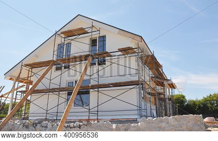 Exterior Renovation Of The House By Rendering, Insulating, Plastering, Applying Stucco And Painting
