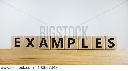 Examples Symbol. Concept Word 'examples' On Wooden Cubes On A Beautiful Wooden Block. White Backgrou