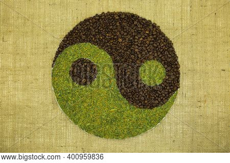 The Concept Of Yin Yang. Sign Yin Yang Against The Background Of Burlap. Japanese Match Tea With Fri