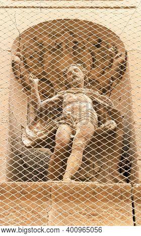 Elche, Alicante, Spain- December 20, 2020: Statue Of Jesus Christ On The Facade Of Santa Maria Churc