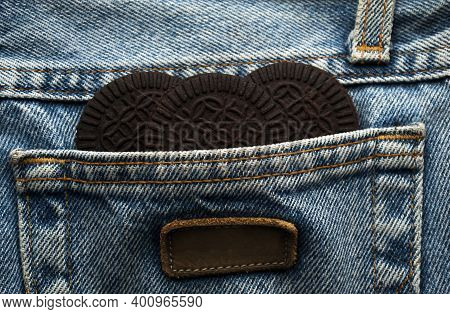 Cookies In My Pants Pocket. Cookies On A Blue Jeans Fabric Background. Takeaway Food. Delicious Blac