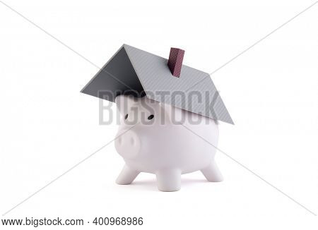 Piggy bank with house roof on white background with clipping path