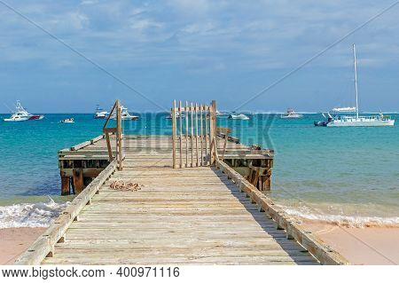 Punta Cana, Dominican Republic - March 11, 2020: Beautiful Abstract With Old Wooden Pier And Yachts.