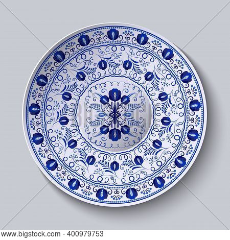 Porcelain Plate With Blue Round Ornament In Ethnic Style. Decorative Pattern In The Style Of Nationa