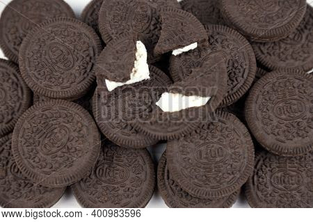 Oreo Sandwich Cookies On White Table. Oreo Is A Sandwich Cookie With A Sweet Cream Is The Best Selli