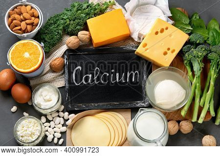 Healthy Diary And Non-diary Products Rich In Calcium On Dark Background