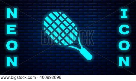 Glowing Neon Tennis Racket Icon Isolated On Brick Wall Background. Sport Equipment. Vector Illustrat