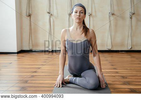 Young Beautiful Woman Practicing Yoga In Yoga Studio. Harmony, Balance, Meditation, Relaxation, Heal