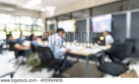 Office Meeting Blur Background With Business People Working Group In Boardroom Discussion For Teamwo