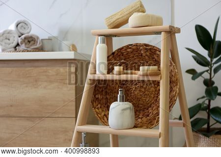 Dispensers And Different Toiletries On Decorative Ladder In Bathroom, Closeup. Idea For Interior Des