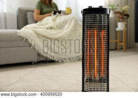 Woman With Cat At Home, Focus On Electric Halogen Heater, Closeup
