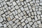 grey pavement of cobble stones as background poster