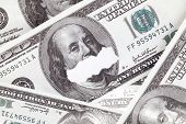 A close-up image of a mouth scratch on the one hundred US dollar poster
