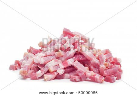 closeup of a pile of raw chopped bacon on a white background