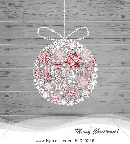 Christmas ball with snowflakes on wood background. Vector illustration.