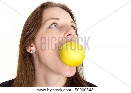 Woman Biting A Yellow Apple