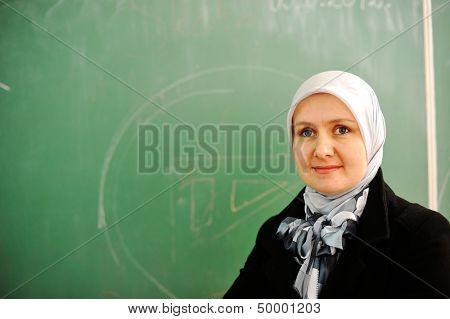 Muslim female teacher at school