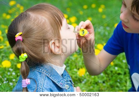 Brother Spraying Nose His Sister