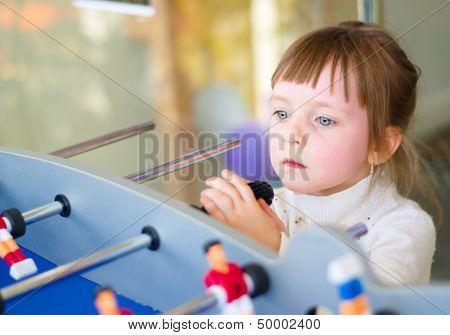 Girl Playing Board Football