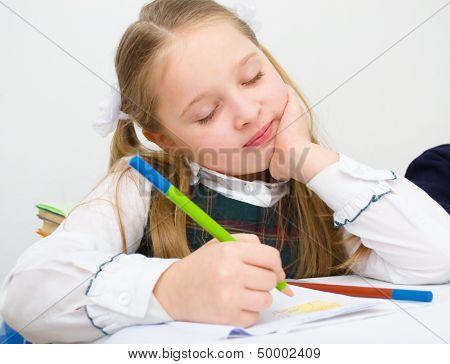 Schoolgirl Drawing With Pencils