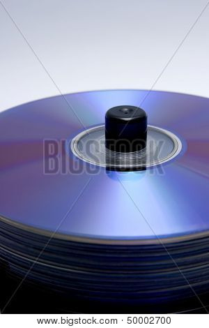 stack of blank cdrom or dvd ready to burn music mp3 movies or backup data poster