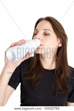 Woman Holding A Bottle Of Lactose Free Milk