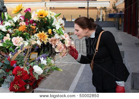 Woman Smelling Colorful Flowers