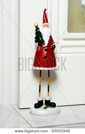 Father Christmas doorstop.