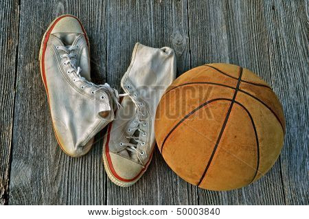 pair of tennis shoes and a basketball