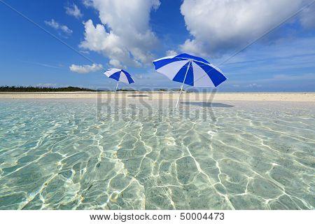 The beach and the beach umbrellas of midsummer.
