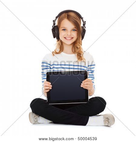 music, technology and shopping concept - child with headphones showing tablet pc
