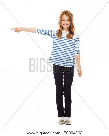 education, school and gesture concept - cute little girl pointing to the side