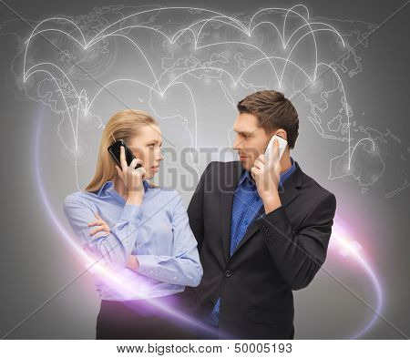 business, technology, communication and networking concept - man and woman calling with smartphones and virtual screen