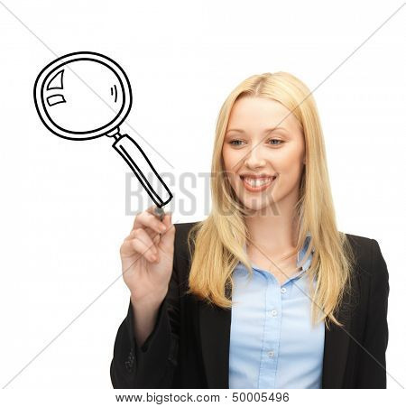 education, science and search concept - woman drawing magnifier on virtual screen