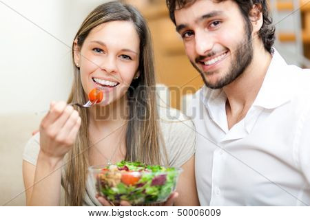 Happy couple eating healthy food